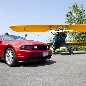 Mustang and biplane
