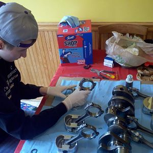 my daughter assembling pistons with me