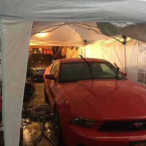 C63 and Mustang both tucked away in dry areas (tent was a little leaky in a few places but I persevered) :D