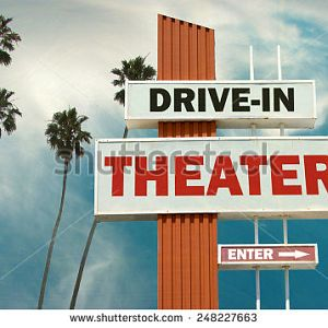 stock photo aged and worn vintage photo of drive in theater sign with palm trees 248227663